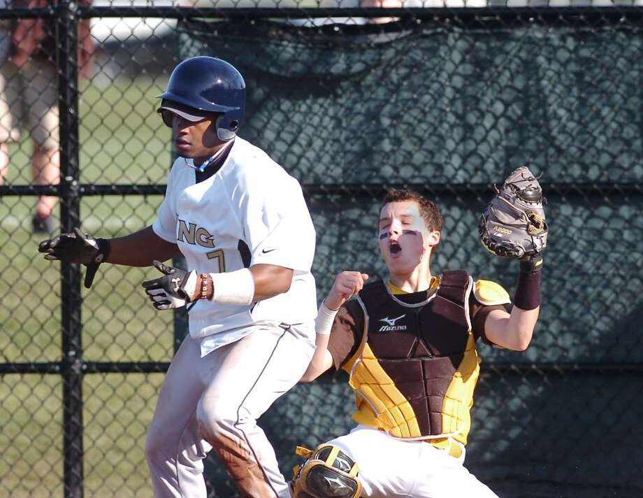 Brunswick catcher, J.P. Bowgen, reacts after King runner Eric Joyner, # 7, left,  was called safe at home plate during a play at the plate in the top of the 4th inning, at Brunswick School, Greenwich, Conn., April lst, 2010. Photo: Bob Luckey / Greenwich Time