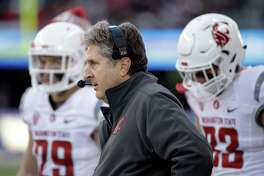 Washington State head coach Mike Leach stands on the sidelines in a game against Washington on Nov. 27, 2015, in Seattle.