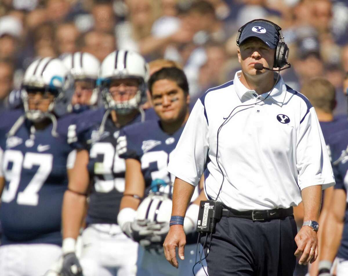 BYU coach Bronco Mendenhall walks the sideline during a game against UCLA in Provo, Utah, in 2013.