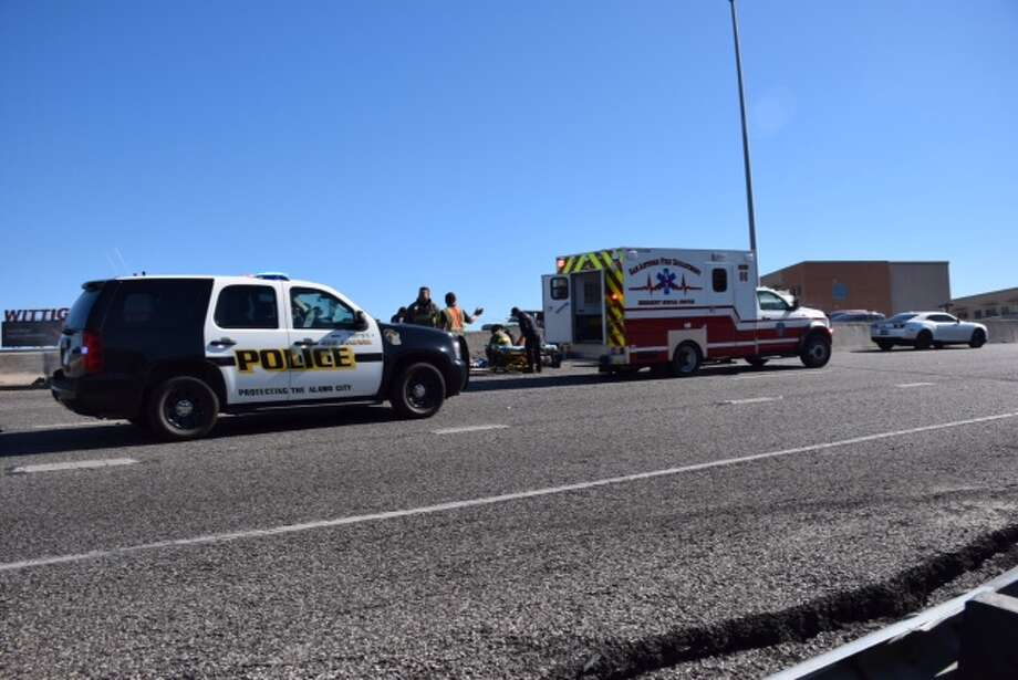 At least one person was transported to an area hospital following a multi-car crash on southbound U.S. 281 near downtown San Antonio on Friday, Dec. 18, 2015. Police responded to the accident shortly after noon near Josephine Street on the highway. Two lanes are completely shut down, causing traffic to back up for miles. Photo: Mark D. Wilson/San Antonio Express-News