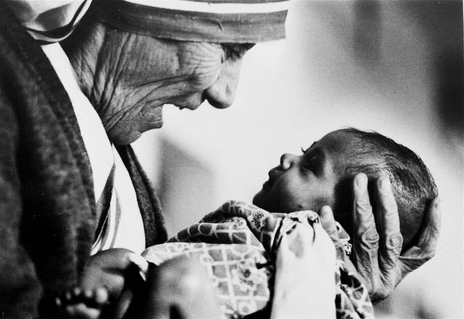 Mother Teresa cradles an armless baby girl at her order's orphanage in what was then known as Calcutta, India, in 1978. She won the Nobel Peace Prize in 1979 for her work with the poor. Photo: Eddie Adams, Associated Press