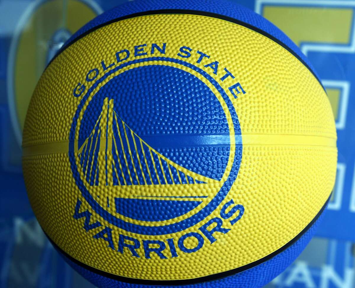 The Golden State Warriors logo is seen on a basketball for sale at the Warrior team store Wednesday, July 14, 2010, in Oakland, Calif.