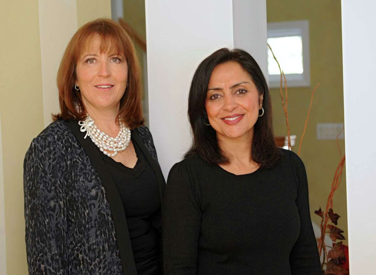 Tangible Development LLC business partners Vera Dordick, left, and Sujata Chaudhry at Sujata's home on Thursday, Jan. 9, 2014 in Schenectady, N.Y. (Lori Van Buren / Times Union) ORG XMIT: MER2014010912144420