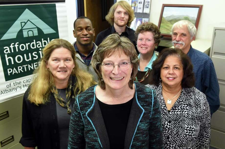 Executive director Susan Cotner, center, with her team on Wednesday, Nov. 18, 2015, at the AHP Homeownership Center in Albany, N.Y. Joining her, clockwise from left, are Louise McNeilly, Orin Harcourt, Jeremy Eberhardt, Eileen Murray, Roger Markovics and Sandra Santoro. (Cindy Schultz / Times Union) Photo: Cindy Schultz / 00034286A