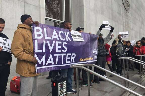 Protesters gather outside the Hall of Justice on Bryant Street Friday morning, demanding San Francisco Police Chief Greg Suhr resign over the recent officer-involved fatal shooting of Mario Woods in the city's Bayview neighborhood.