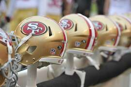 A general view of San Francisco 49ers helmets on the bench during during an NFL football game between the Cleveland Browns and the San Francisco 49ers Sunday, Dec. 13, 2015, in Cleveland. Cleveland won 24-10. (AP Photo/David Richard)