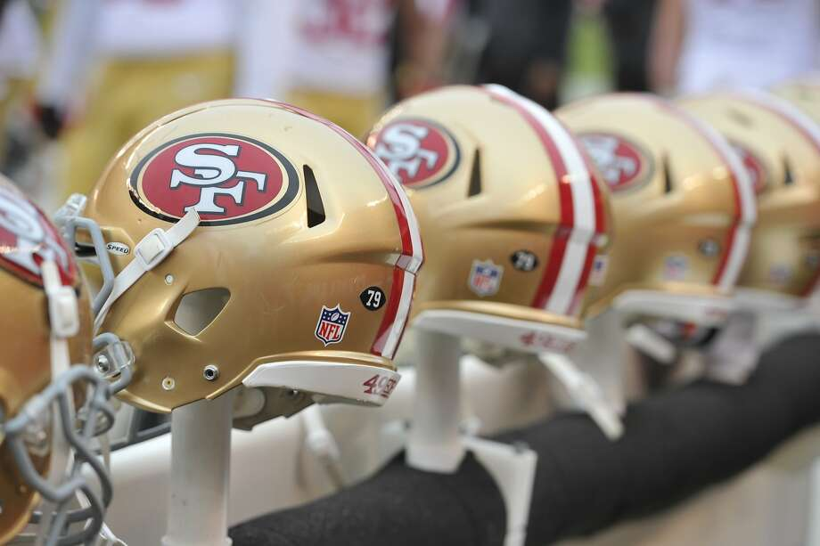 Thanks to a $140,000 grant from the 49ers Foundation, the city Police  Athletic League's football and cheerleading teams will get new  equipment and uniforms bearing the Niners' colors and logo. Photo: David Richard, Associated Press