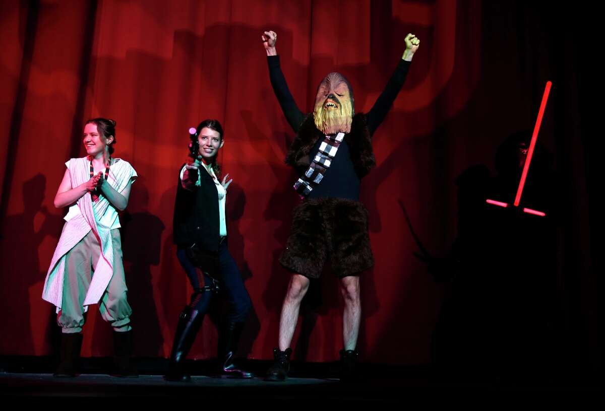 """(Left to right) Jade Vallejo, Chelsea Harris and David Bower take part in a costume contest before the first showing of """"Star Wars: The Force Awakens"""" at the Alamo Drafthouse on Mission in San Francisco, on Thursday, December 17, 2015."""