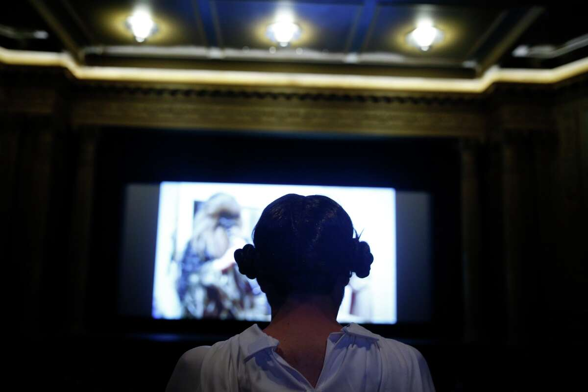 """Dressed as Princess Leia, Joe Kukura waits for the start of """"Star Wars: The Force Awakens"""" at the Alamo Drafthouse on Mission in San Francisco, on Thursday, December 17, 2015."""