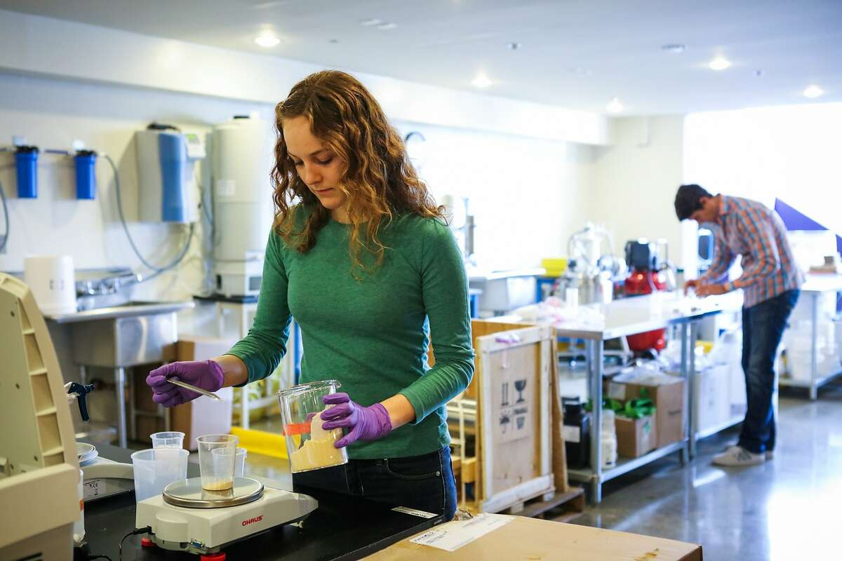 Bridget Smith, associate scientist at Ripple Foods, measures pea protein for an experiment at the Ripple Foods' test lab in Emeryville, California on Thursday, December 17, 2015.