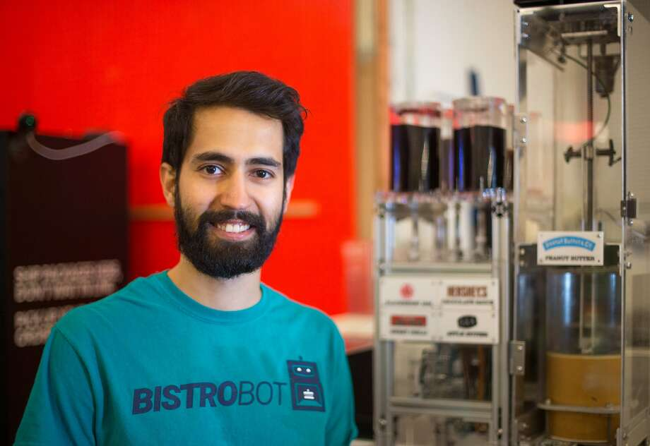 Hamid Sani, co-founder of Bistrobot, poses for a photo next to his PB&J machine at Andi's Market in Bernal Heights on Friday, Dec. 4, 2015 in San Francisco, Calif. Photo: Nathaniel Y. Downes, The Chronicle