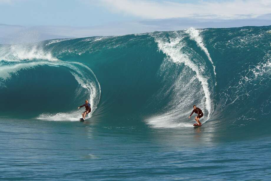 """In this image provided by Warner Bros. Entertainment Inc., Luke Bracey plays Utah, left, and Edgar Ramirez plays Bodhi in a scene from """"Point Break."""" In a remake of the 1990s cult classic """"Point Break,"""" extreme sports of every kind, not just surfing, take center stage and the filmmakers used athletes, not stuntmen, to make the scenes as realistic as possible. (Reiner Bajo/Warner Bros. Entertainment Inc. via AP) Photo: Reiner Bajo, Associated Press"""