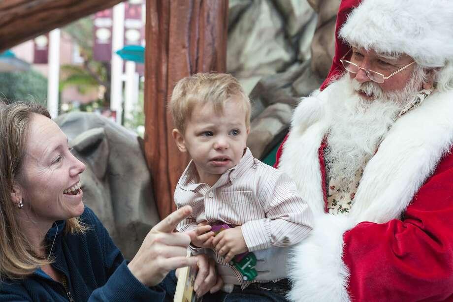 In this file photo, Kair Gebauer assures Brady Gebauer, 3, that Santa is fun. Photo taken on Dec. 8, 2013 in Palo Alto. Photo: Scott R. Kline