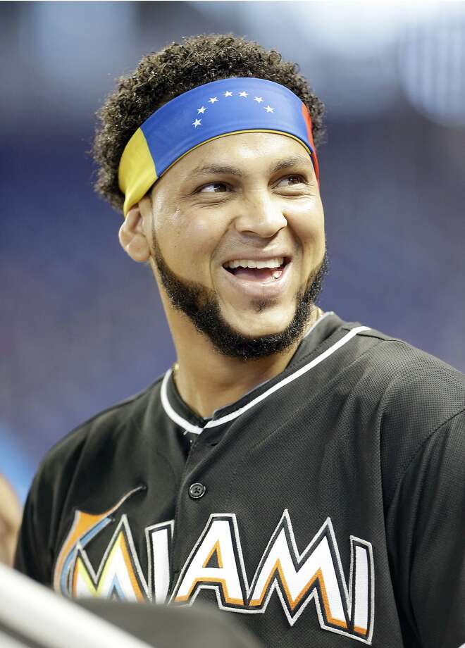 Miami Marlins pitcher Henderson Alvarez wears a Venezuelan headband before the start of a baseball game against the Oakland Athletics, Saturday, June 28, 2014 in Miami. (AP Photo/Wilfredo Lee) Photo: Wilfredo Lee, Associated Press