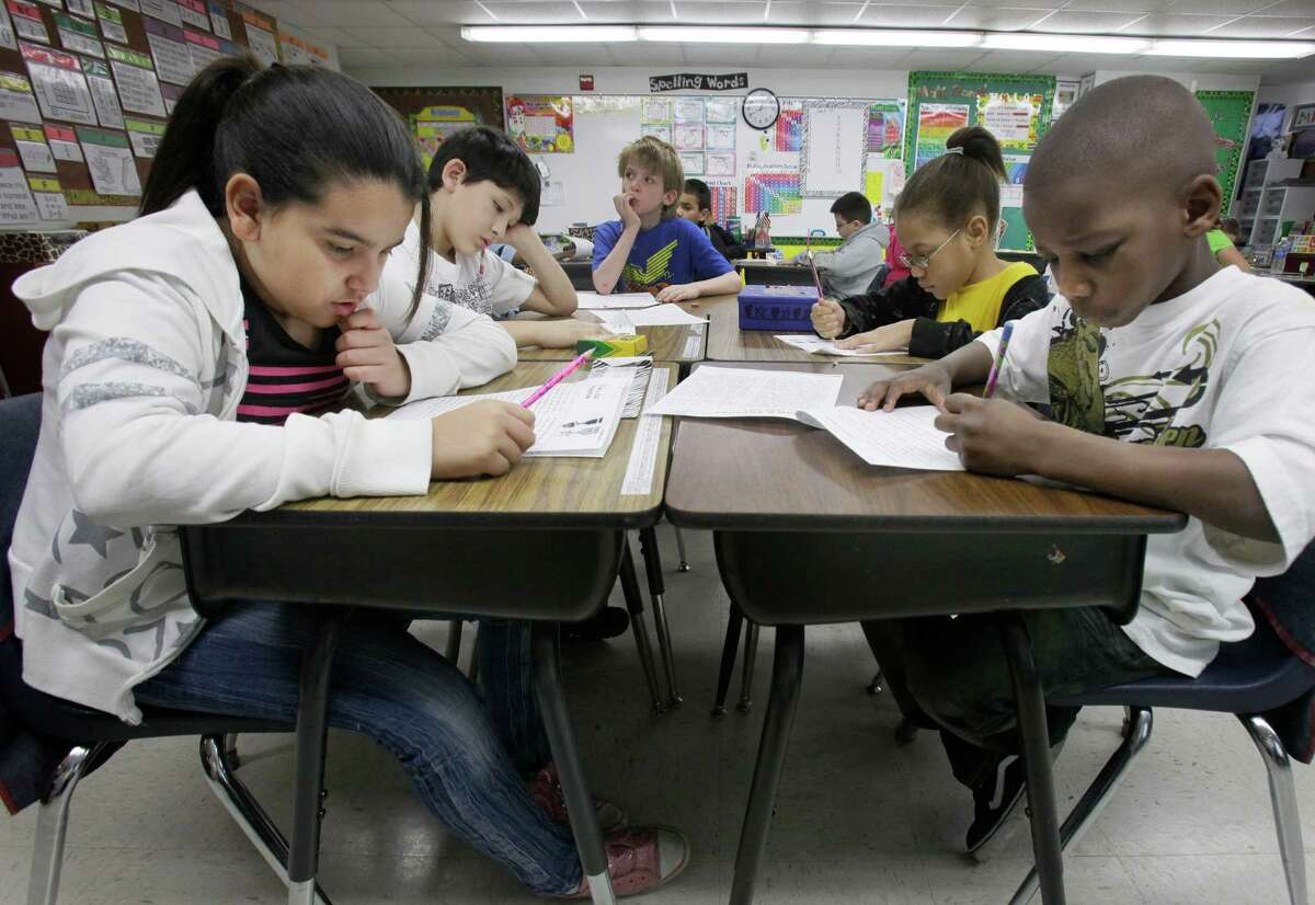 In 2011, third grade students do school work during class at Hanby Elementary School in Mesquite, Texas. Latinos are now the majority of state public school students. Helping them succeed is crucial to Texas' future.