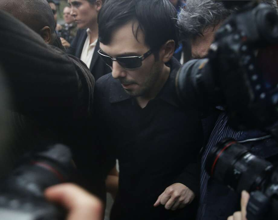 Martin Shkreli leaves the courthouse after his arraignment in New York, Thursday, Dec. 17, 2015. Shkreli, the former hedge fund manager vilified widely for buying a pharmaceutical company and jacking up the price of a life-saving drug more than fiftyfold, was arrested Thursday on securities fraud charges unrelated to the furor. (AP Photo/Seth Wenig) Photo: Seth Wenig, Associated Press