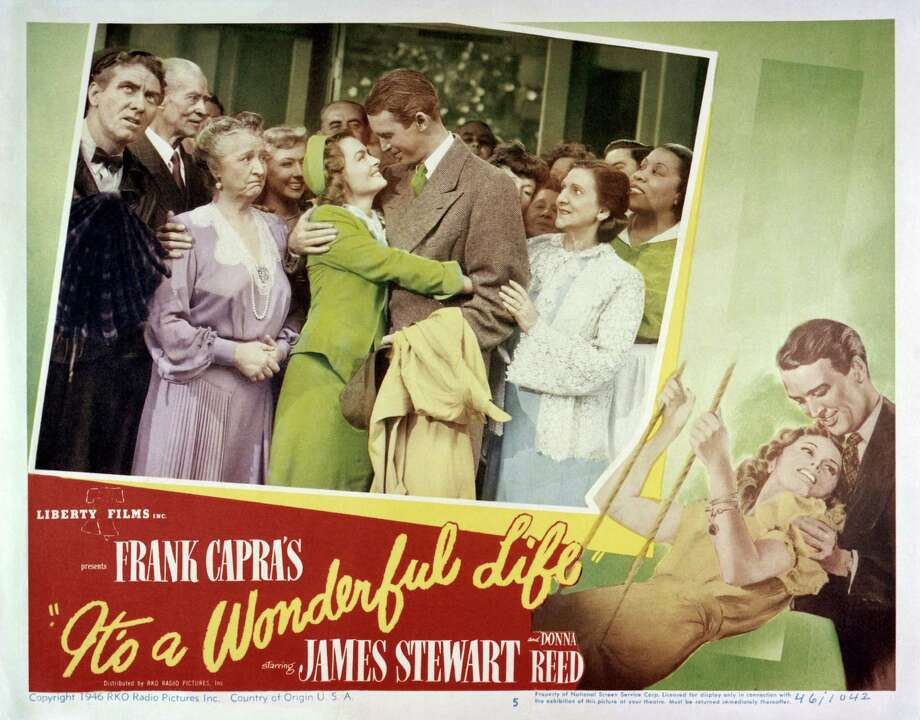 A poster for Frank Capra's 1946 comedy-drama 'It's A Wonderful Life', starring James Stewart and Donna Reed (centre). Left to right; Frank Faylen, H.B. Warner, Sarah Edwards, Gloria Grahame, Reed, Stewart, Beulah Bondi and Lillian Randolph. (Photo by Silver Screen Collection/Getty Images) Photo: Silver Screen Collection, Contributor / 2014 Silver Screen Collection