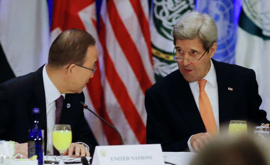 """United Nations Secretary General Ban Ki-moon, and Unites States Secretary of State, John Kerry speak before a meeting of the International Syria Support Group at a hotel in New York,  Friday, Dec. 18, 2015. Nations meeting Friday in New York and the U.N. will essentially be negotiating a Russian plan for a """"political transition,"""" based on the Syrian government's consent and with no clear reference to President Bashar Assad's departure. (Carlo Allegri/Pool Photo via AP) Photo: Carlo Allegri, POOL / POOL Reuters"""