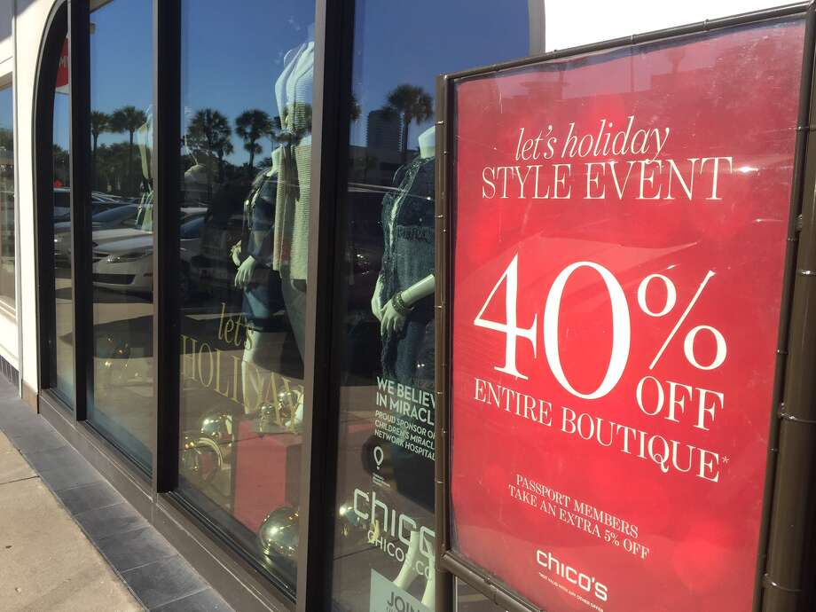 Bevello, a women's boutique on West Gray, was promoting a storewide sale this week. A warm fall over much of the U.S. likely cut into coat purchases. Photo: Sarah Scully