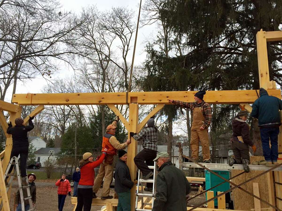 Dan Brudos directs the crew putting up the frame for Ken and Jill Busman's home in Scotia on Nov. 14, 2015.