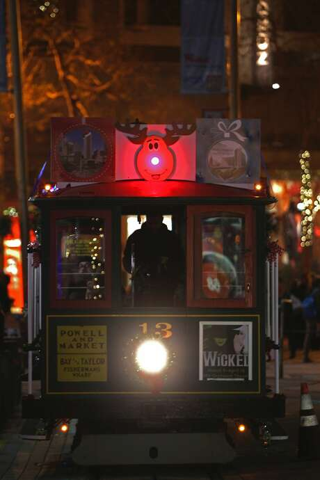 Rudolph makes an appearance  on one of Municipal Railway's historical Cable Cars at the Market and Powell Street turnaround in San Francisco on December 17, 2015. Photo: Franchon Smith