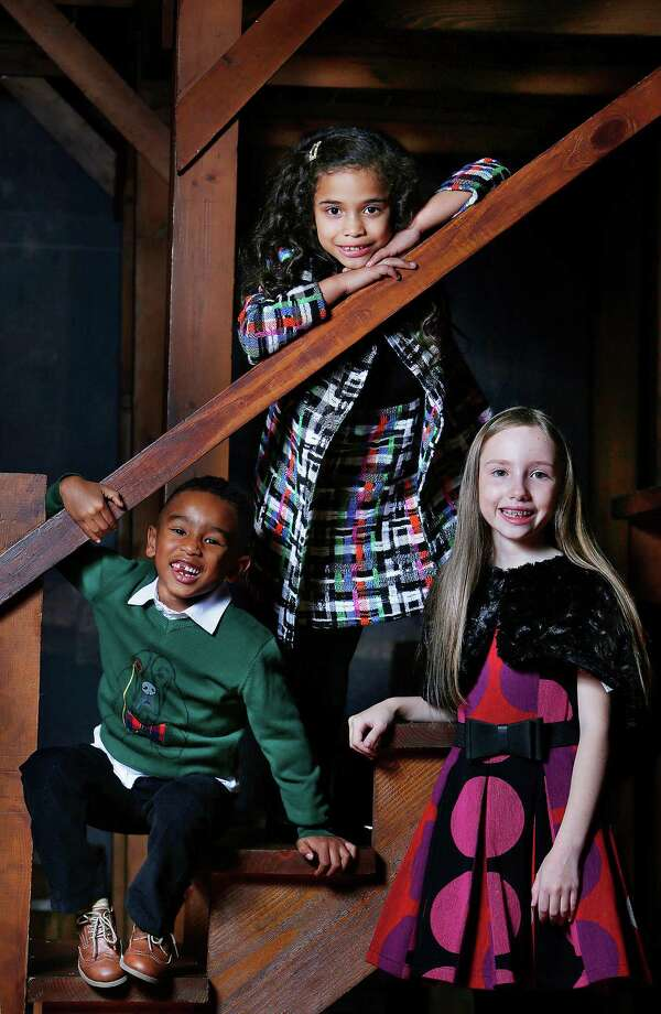 Dylan Anderson, 4, left, is wearing a Andy and Evan black pants, $39 (sale), and sweater, $36 (sale), and Armani Junior shirt, $125. Samantha Chavez, 6, top, is wearing a MILLY Minis dress, $215, and double-breasted coat, $281 (sale). Hazel Dansby, 10, is wearing a Zoe LTD dress, $225, and faux-fur shrug, $102. All from Neiman Marcus. Shot on location at The Alley Theatre. Fashion styling by Joy Sewing. Photo: Mark Mulligan, Staff / © 2015 Houston Chronicle