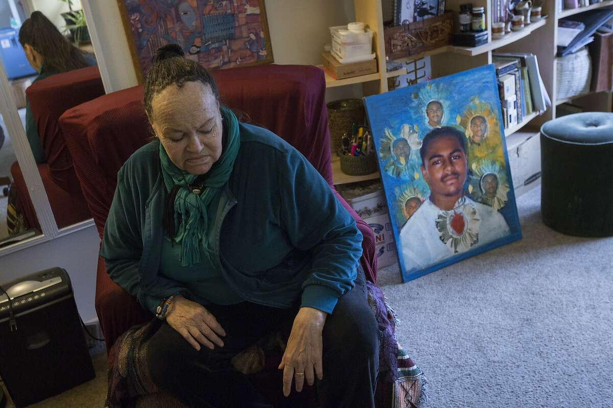 Mesha Monge-Irizarry speaks about her son, Idriss Stelley, and the crisis intervention training program, Friday, Dec. 18, 2015, in San Francisco, Calif. A portrait of him is seen on the right. Stelley, who may have suffered a mental breakdown, was shot and killed by S.F. police after police said Stelley was brandishing a knife.