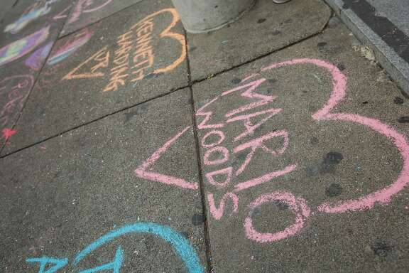 Demonstrators chalked up the ground outside Hall of Justice in protest of alleged police brutality and those killed by police officers, Friday, Dec. 18, 2015, in San Francisco, Calif. Mario Woods was shot an killed by police officers after police say he walked toward officers with a knife.