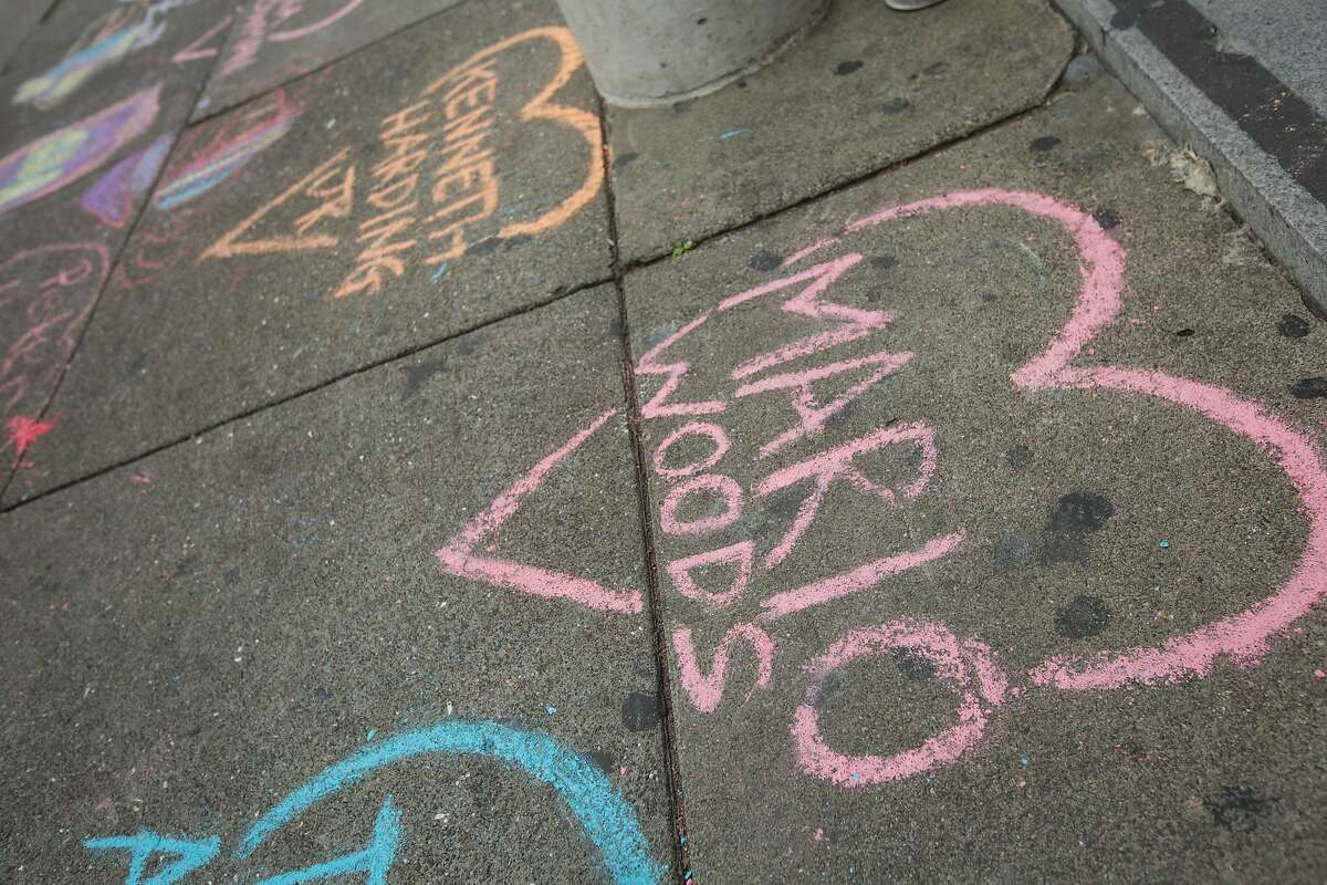 In this file photo, demonstrators chalked up the ground outside Hall of Justice in protest of alleged police brutality and those killed by police officers, Friday, Dec. 18, 2015, in San Francisco, Calif. Mario Woods was shot an killed by police officers after police say he walked toward officers with a knife.