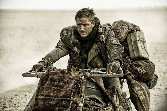 "This photo provided by Warner Bros. Pictures shows Tom Hardy, as Max Rockatansky, in Warner Bros. Pictures' and Village Roadshow Pictures' action adventure film, ""Mad Max:Fury Road,"" a Warner Bros. Pictures release.  AP film writers Jake Coyle and Lindsey Bahr select their picks for the best movies of the year in 2015, including ""Mad Max: Fury Road,"" ""Carol,"" ""Kumiko, The Treasure Hunter,""  ""Spotlight,"" and others. (Jasin Boland/Warner Bros. Pictures via AP)"