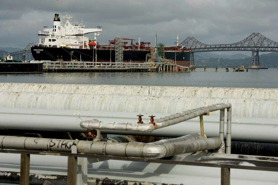 Oil tankers like this one docked near a Chevron refinery in Richmond, Calif., will be able to carry U.S. oil overseas for the first time since the 1970s.  Photo: David Paul Morris / © 2014 Bloomberg Finance LP