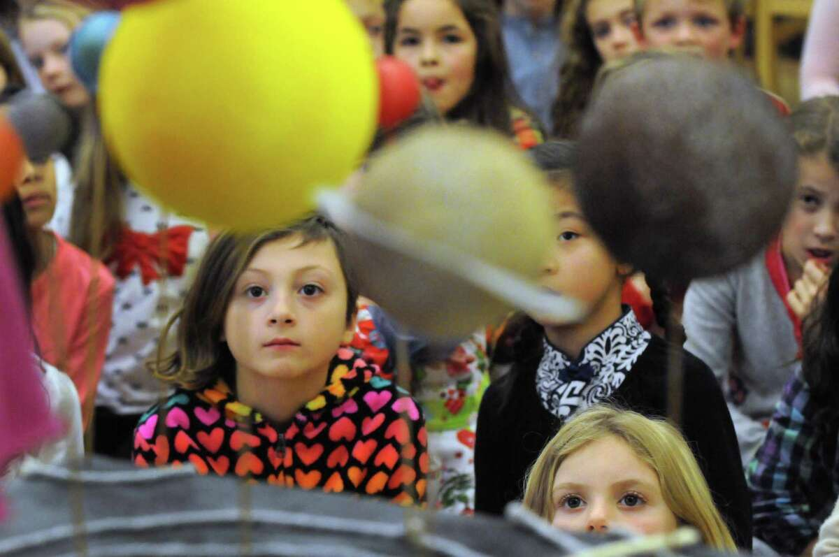 Elementary school students listen as middle school students present autobiographies of astronomers throughout history at Woodland Hill Montessori School on Friday Dec. 17, 2015 in North Greenbush, N.Y. (Michael P. Farrell/Times Union)
