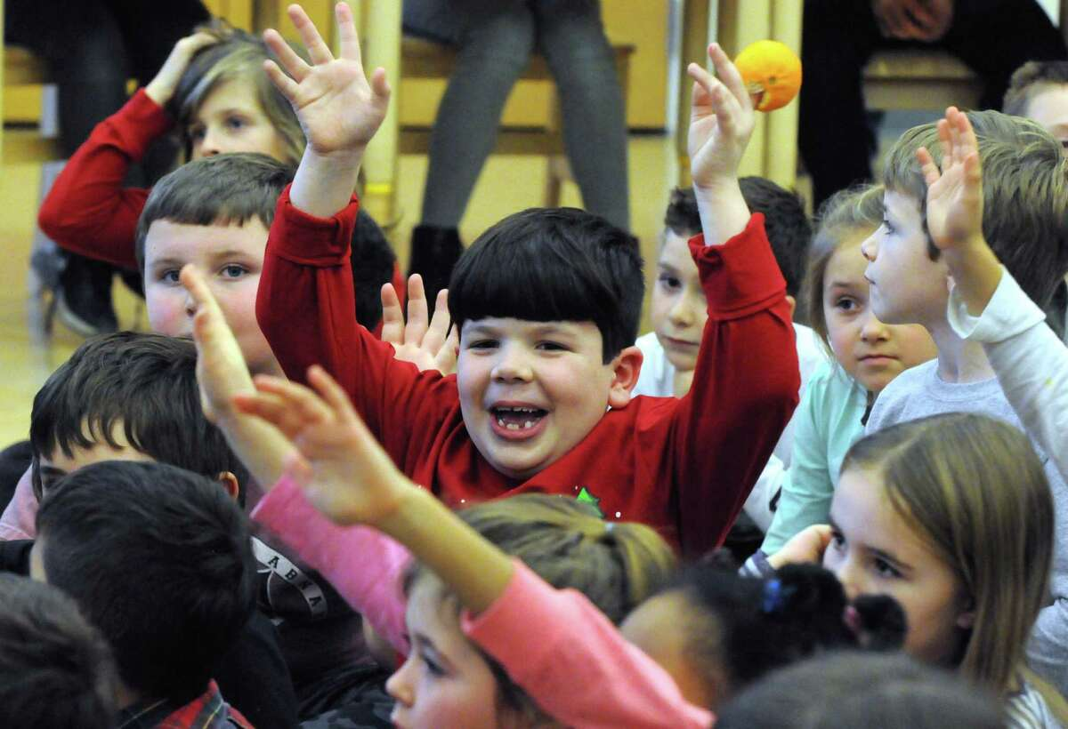 Elementary school students interact as middle school students present autobiographies of astronomers throughout history at Woodland Hill Montessori School on Friday Dec. 17, 2015 in North Greenbush, N.Y. (Michael P. Farrell/Times Union)