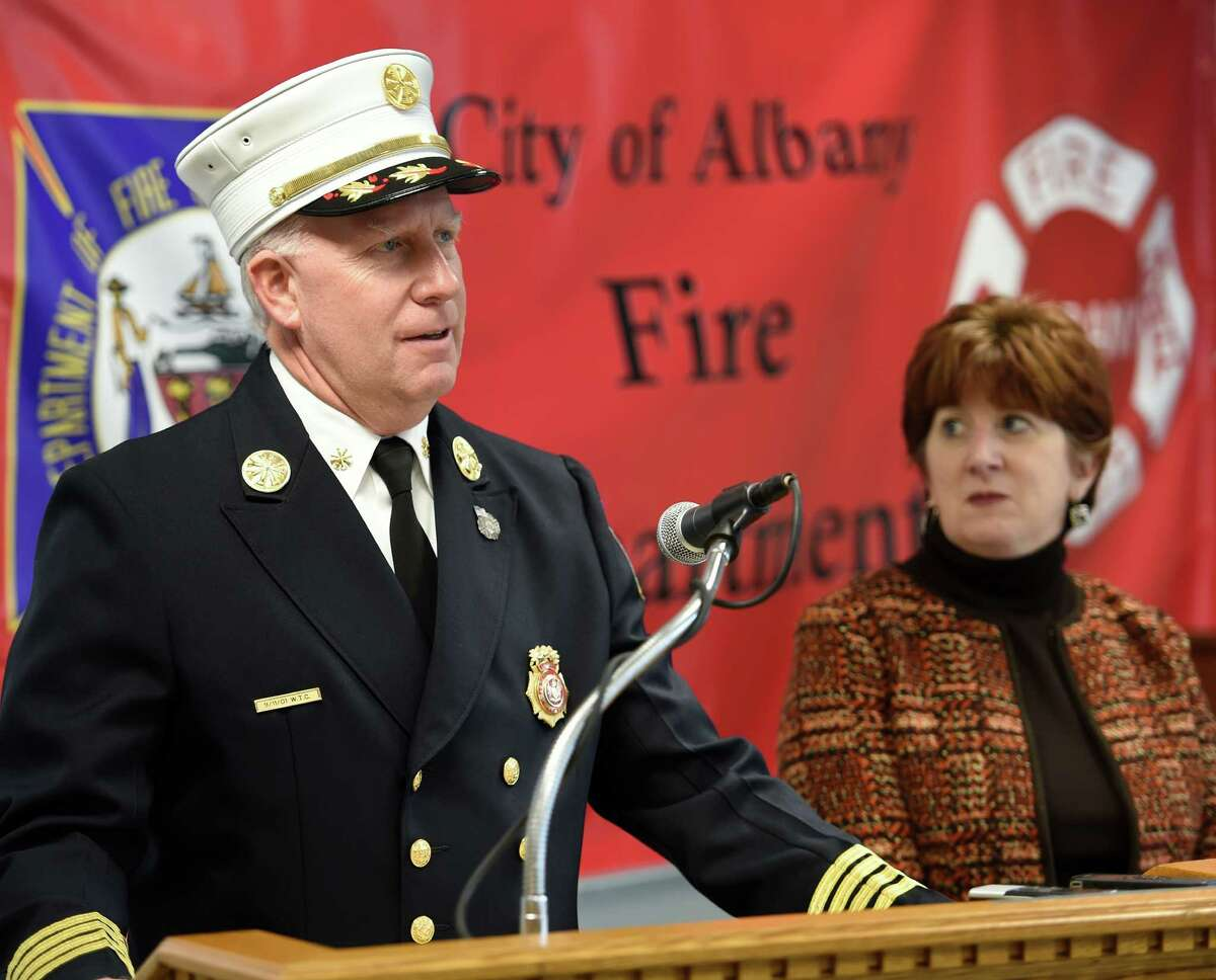 Deputy Fire Chief Joseph Toomey, left and Mayor Kathy Sheehan, right, addresse a press conference regarding the Park Avenue fire Thursday Dec. 3, 2015 at the Albany Fire Department headquarters in Albany, N.Y. (Skip Dickstein/Times Union)