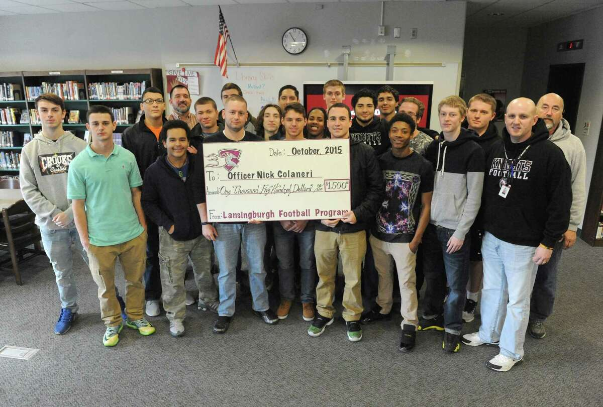 Lansingburgh HS Coaches vs Cancer donated $1,500 to Nick Colaneri, a Hoosick Falls officer who has beat cancer but has medical bills, on Friday Dec. 18, 2015 in Troy, N.Y. (Michael P. Farrell/Times Union)