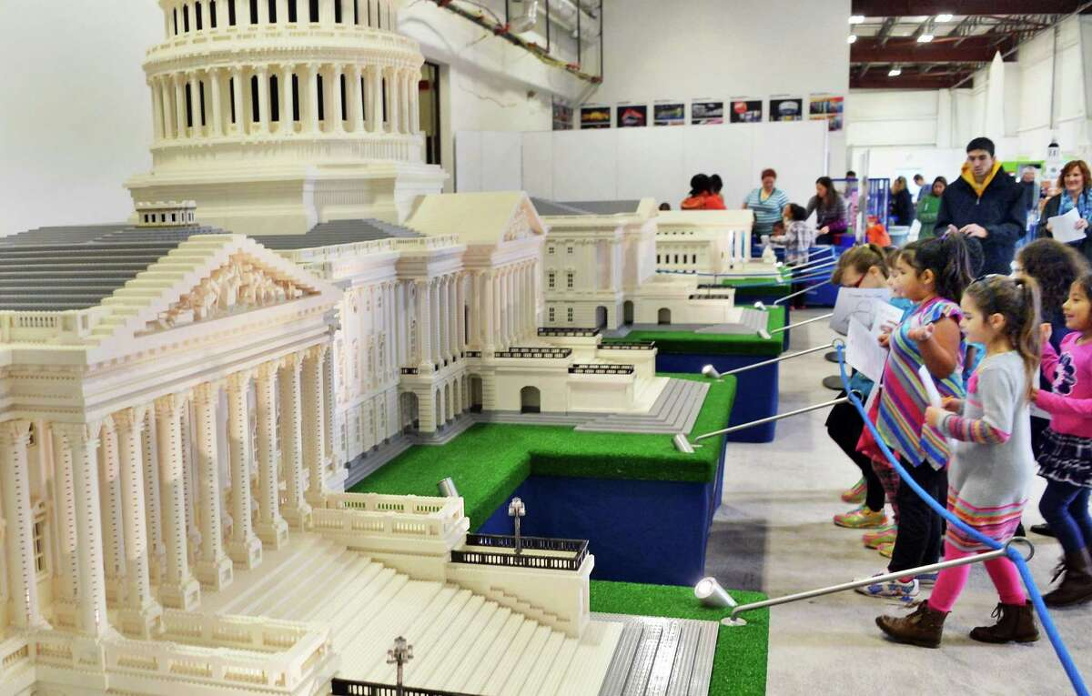 First graders from School 14 in Troy check out a Lego model of the US Capitol complex from the LEGO Americana Roadshow at the exhibit design and fabrication provider Creatacor, Inc., Friday Dec. 18, 2015 in Halfmoon, NY. (John Carl D'Annibale / Times Union)