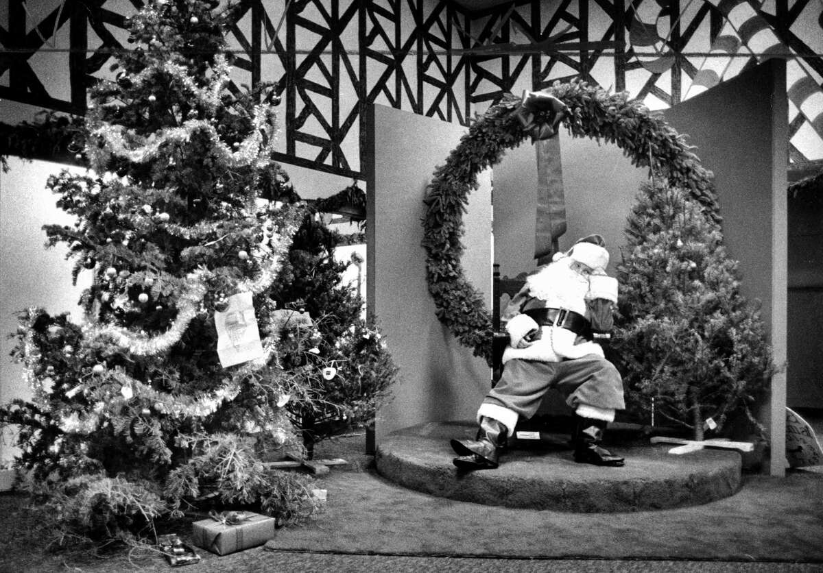 Santa takes a break: Terrence Todd at the Great American Christmas in 1976 at Macy's.
