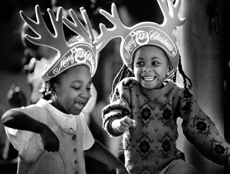 Marisha Malone and Tamama Dickson dance with their antlers at the Oakland Christmas parade in 1989. Photo: Chris Stewart / The Chronicle / ONLINE_YES