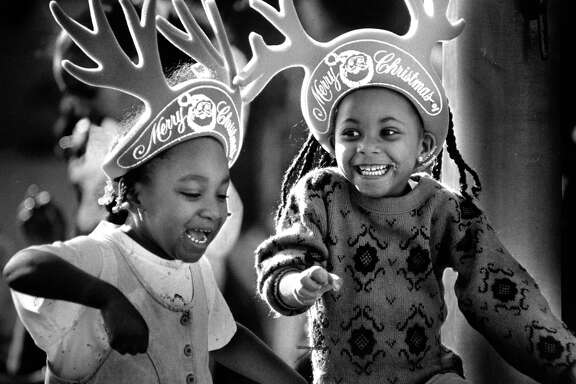 Marisha Malone and Tamama Dickson dance with their antlers on at the Oakland Christmas parade in 1989.