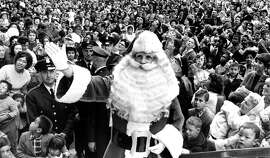 The Emporium Santa leads his followers on Market Street, Nov. 7, 1964.