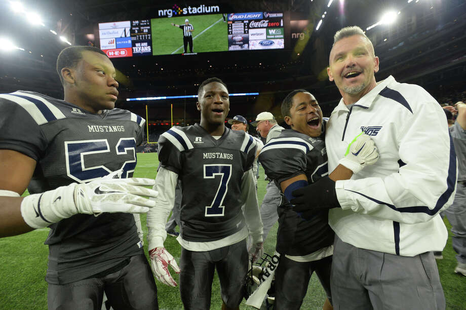 West Orange-Stark's players and coaches celebrate after defeating Celina 22-3 and earning the state championship during Friday's state finals game at NRG Stadium in Houston.  