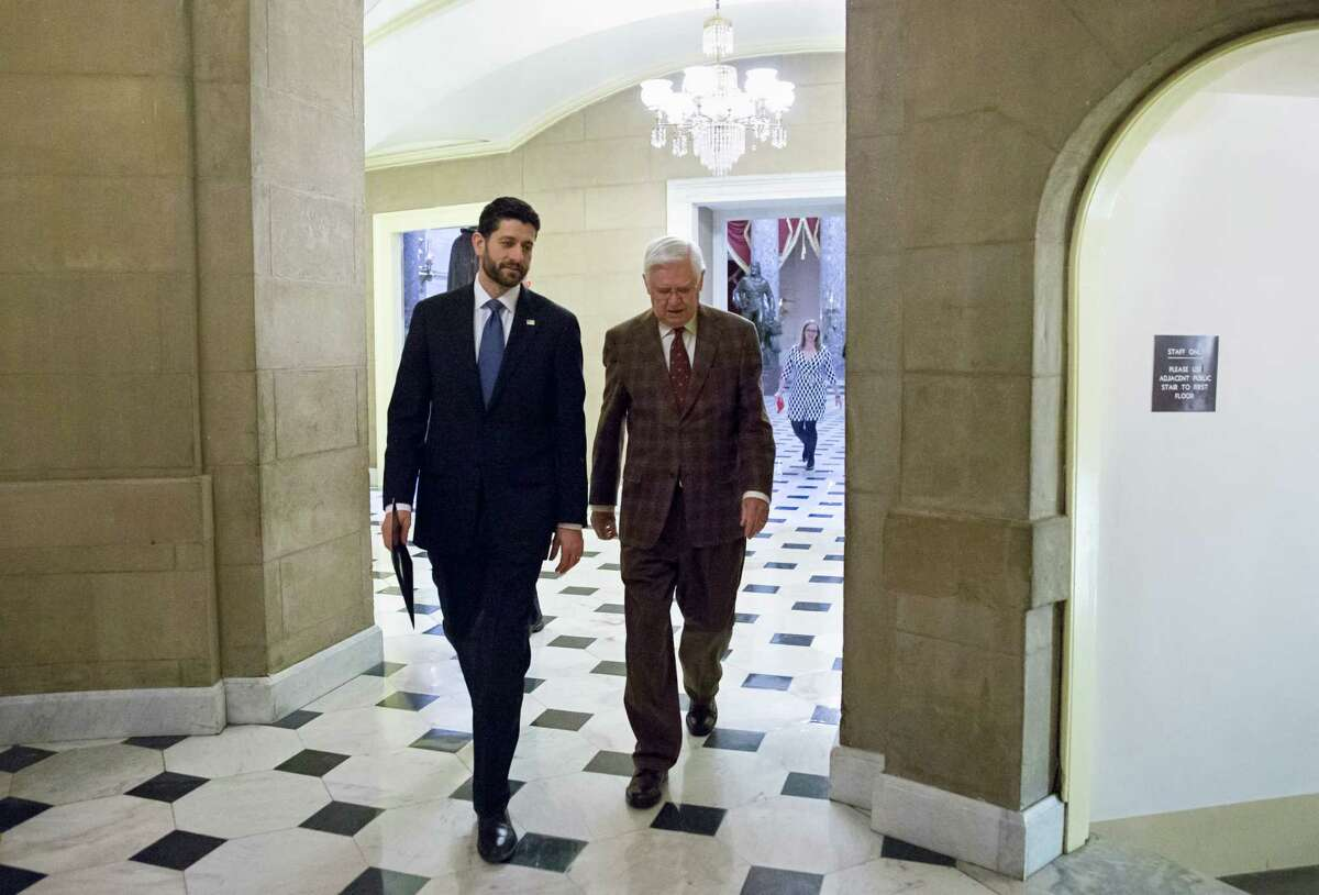Speaker of the House Paul Ryan, R-Wis., left, and Appropriations Committee Chairman Hal Rogers, R-Ky., return to Ryan's office after passing the omnibus bill, at the Capitol in Washington, Friday, Dec. 18, 2015. The House easily passed a $1.14 trillion spending bill to fund the government through next September, capping a peaceful end to a yearlong struggle over the budget, taxes, and Republican demands of President Barack Obama. (AP Photo/J. Scott Applewhite)