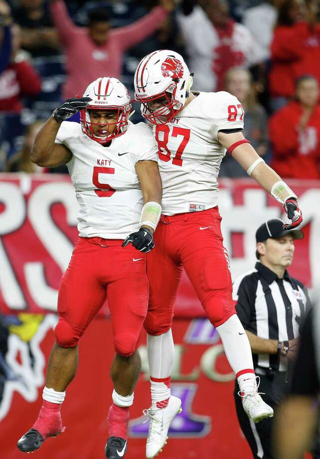 Kyle Porter, left, and teammate Parker Eichenberger have a lot of practice celebrating touchdowns, but Katy's defense is the rock of the team. Photo: Karen Warren, Staff / © 2015  Houston Chronicle