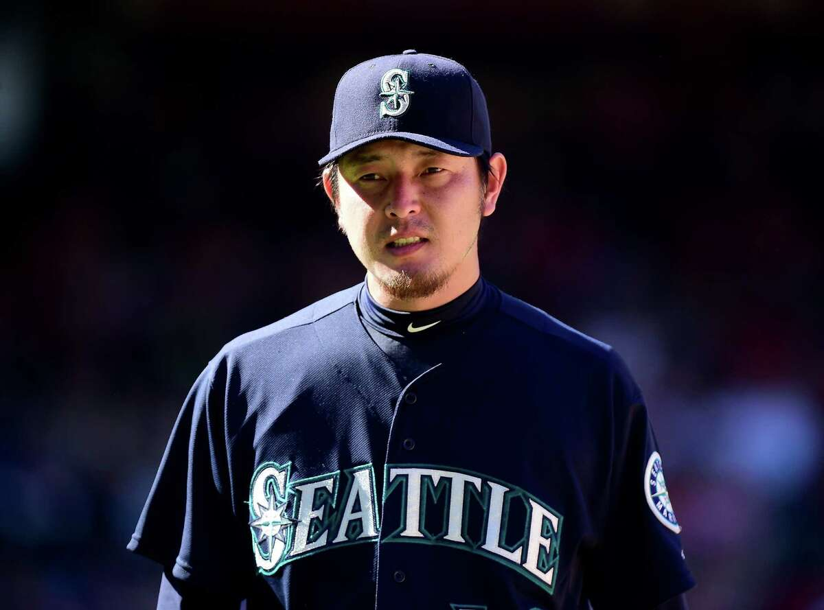 ANAHEIM, CA - SEPTEMBER 27: Hisashi Iwakuma #18 of the Seattle Mariners reacts as he leaves the game during the eighth inning at Angel Stadium of Anaheim on September 27, 2015 in Anaheim, California. (Photo by Harry How/Getty Images) ORG XMIT: 538595785