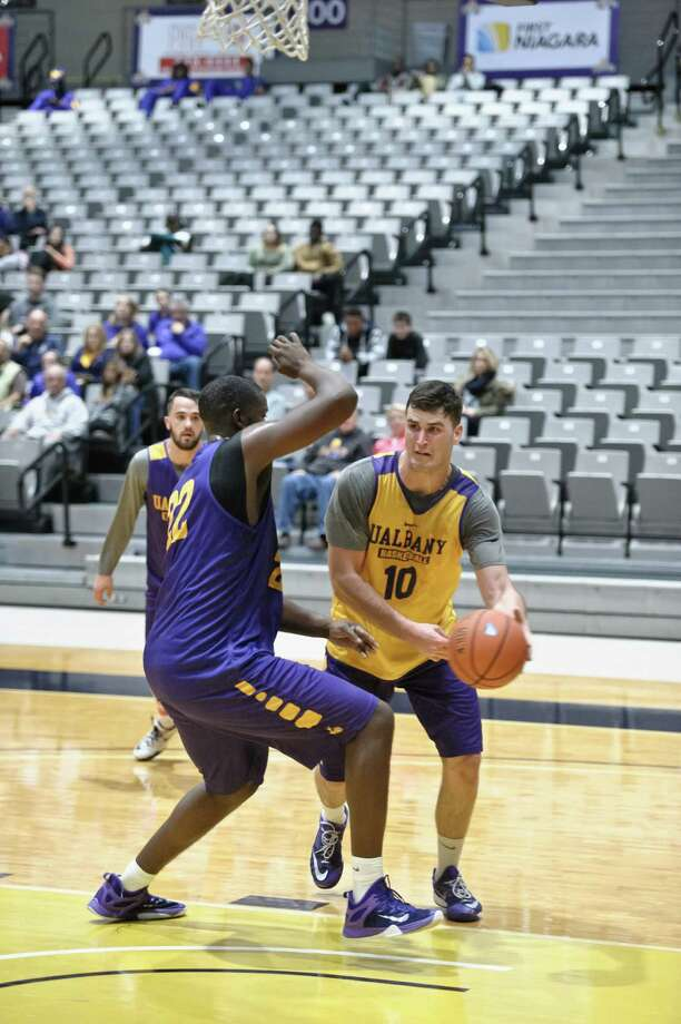U Albany's Mike Rowley looks for an open teammate past Richard Peters during the scrimmage game at SEFCU Arena Saturday, October 17th, 2015. Photo By Eric Jenks, for the Times Union Photo: Eric Jenks / Eric Jenks 2015