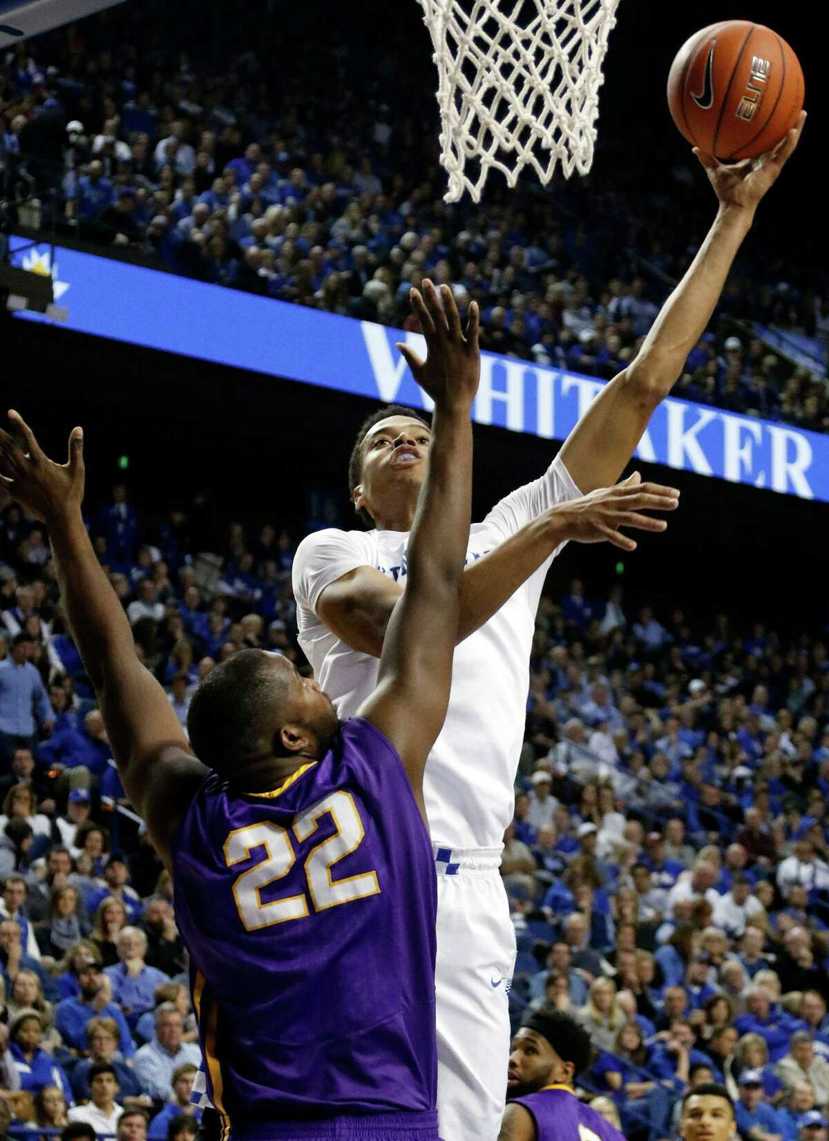Kentucky's Skal Labissiere, right, shoots over the defense of Albany's Richard Peters during the second half of an NCAA college basketball game Friday, Nov. 13, 2015, in Lexington, Ky. Kentucky won 78-65. (AP Photo/James Crisp) ORG XMIT: KYJC111