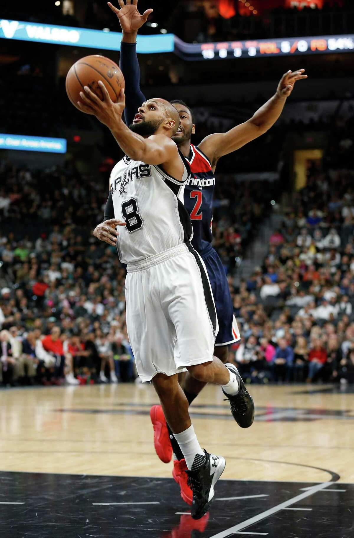 Spurs' Patty Mills (08) drives past Washington Wizards' John Wall (02) at the AT&T Center on Wednesday, Dec. 16, 2015. Spurs defeated the Wizards, 114-95. (Kin Man Hui/San Antonio Express-News)