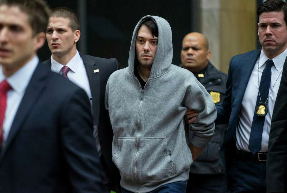 FILE - In this Dec. 17, 2015 file photo, Martin Shkreli, the former hedge fund manager under fire for buying a pharmaceutical company and ratcheting up the price of a life-saving drug, is escorted by law enforcement agents in New York after being taken into custody following a securities probe.  Shkreli  has resigned as the head of one of the companies he now runs, Turing Pharmaceuticals, on Friday, Dec. 18, 2015.(AP Photo/Craig Ruttle) ORG XMIT: NY125 Photo: Craig Ruttle / FR61802 AP
