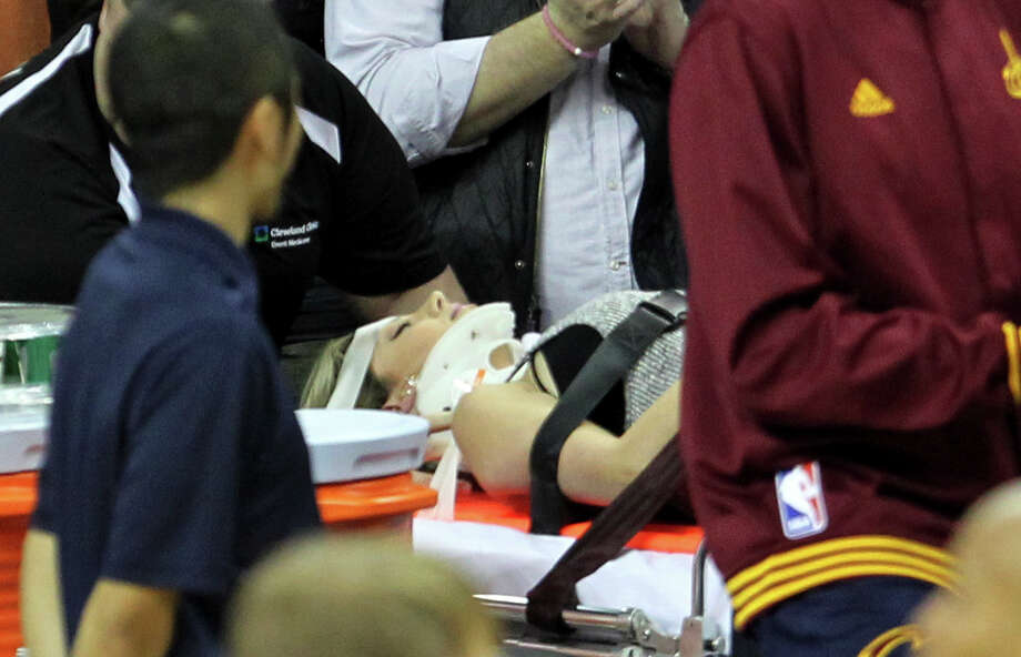 Ellie Day was carried off the floor on a stretcher Thursday night after Cavaliers star LeBron James collided with her. Photo: John Kuntz, MBR / The Plain Dealer