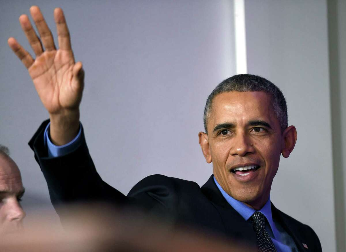 President Barack Obama waves as he leaves following a news conference in the Brady Press Briefing room at the White House in Washington, Friday, Dec. 18, 2015. (AP Photo/Susan Walsh) ORG XMIT: DCSW112